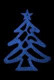 Blue Christmas Tree on black background Royalty Free Stock Photo