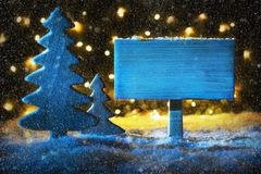 Blue Christmas Tree, Copy Space, Snowflakes, Lights. Sign With Copy Space For Advertisement. Blue Christmas Tree With Snow And Magic Glowing Lights In Backround royalty free stock photography