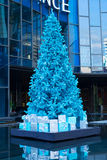 Blue Christmas Tree with gifts. On the pond Royalty Free Stock Image