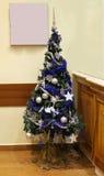 Blue Christmas tree. Inside retro interior with silver ornaments Stock Photos
