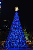 Blue Christmas Tree. Large christmas tree covered in blue lights, with a star Stock Image