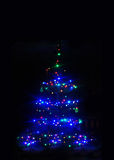 Blue Christmas tree of lights Stock Photos