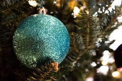 Blue Christmas tree ornament. A Sparkly blue Christmas tree ornament with lights on a tree stock image