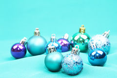 Blue Christmas tree ornaments on blue background. Christmas tree ball ornaments on blue background Royalty Free Stock Image