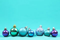 Blue Christmas tree ornaments on blue background - Series 2 Royalty Free Stock Photo