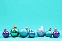 Blue Christmas tree ornaments on blue background - Series 2. Christmas tree ball ornaments on blue background Royalty Free Stock Photo