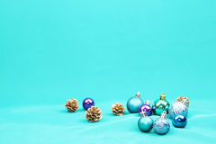 Blue Christmas tree ornaments on blue background - Series 6 Stock Photos
