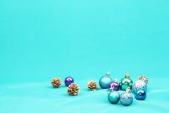 Blue Christmas tree ornaments on blue background - Series 6. Christmas tree ball ornaments on blue background Stock Photos