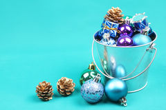 Blue Christmas tree ornaments in steel bucket Stock Image