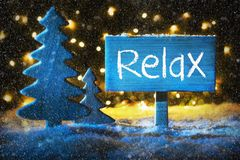 Blue Christmas Tree, Text Relax, Snowflakes, Snow. Sign With English Text Relax. Blue Christmas Tree With Snow And Magic Glowing Lights In Backround And royalty free stock photos