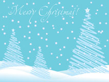 Blue christmas wallpaper with new year trees. And snow and greeting text Stock Photo
