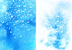 Blue christmas watercolor background with snowflakes Stock Photos