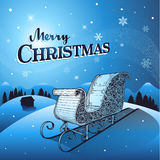 Blue Christmas winter background with santa sleigh Stock Photo