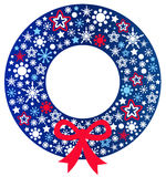 Blue Christmas wreath with ribbon Stock Image