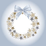 Blue Christmas wreath. With stars and bow Stock Photos