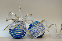 Blue christmass balls and glitter ribbon Stock Image