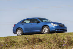 Blue Chrysler Sebring sedan Royalty Free Stock Photography