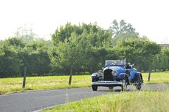 A blue Chrysler 72 takes part to the 1000 Miglia classic car race stock images