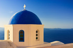 Blue Church Dome, Greece. The dome of a traditional greek church overlooking the sea in Oia, Santorini Stock Images