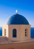 Blue Church Dome, Greece. The dome of a traditional greek church overlooking the sea in Oia, Santorini Stock Photo