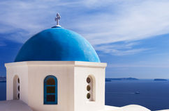 Blue church dome in Santorini, Greece. A church with a blue dome overlooks the spectacular caldera surrounding the beautiful island of Santorini, Greece stock images