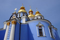 Blue church with golden domes Royalty Free Stock Photos