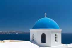 Blue church of Oia village at Santorini island Stock Photo