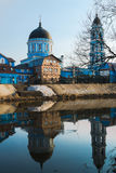 Blue Church. Postcard for the holiday of Easter with blue temple on the banks of the river Royalty Free Stock Image