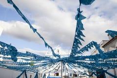 Blue church square, Campo Maior Festival, Portugal. Flower festival in Campo Maior with paper flowers decorared streets,  Portugal Stock Photos