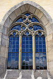 Blue Church window. Church window with beautiful blue sky reflection Stock Image