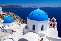 Blue churches of Oia village on Santorini Stock Photo