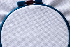 Blue circle and the fabric for embroidery. Closeup Stock Photo