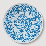 Blue circle floral ornament. Pattern drawing to the ceramic dish. Stock Photos