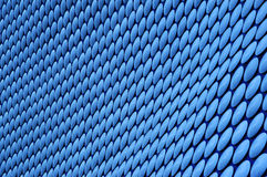 Blue circle pattern. Outside wall of Selfridges in Birmingham. Processed from RAW as if take under incandescent light to give the blue colour - the original Royalty Free Stock Photos