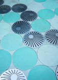 Blue circle pattern floor and round grate drainage channel. Idea for Landscape design Stock Photos