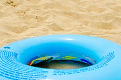 Blue circle on sand Stock Images