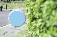 Blue circle signs and wooden arches in the garden stock photo
