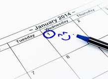 Blue circle with smile. Mark on the calendar at 1St January 2014 Stock Photography