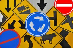 Blue circle roundabout sign on traffic symbol background. Blue circle and white arrows of roundabout sign on traffic symbol background royalty free stock image
