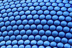 Blue Circles. Outside wall of Selfridges in Birmingham. Processed from RAW as if take under incandescent light to give the blue colour - the original image was a Royalty Free Stock Image
