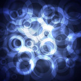 Blue circles on a dark background Stock Photography