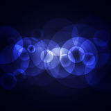 Blue circles on a dark background Royalty Free Stock Photography