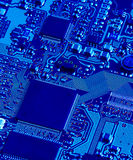 Blue Circuit. A blue-tinged closeup of a electronic circuit board Stock Image