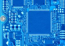 Blue Circuit Board. Close up of computer circuit board in blue Stock Photos