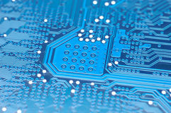 Blue circuit board. Close up of computer circuit board in blue Stock Photo