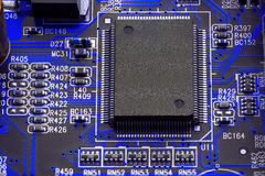 Blue circuit board with cpu. Royalty Free Stock Images