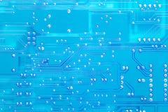 Blue circuit board texture. Closeup Stock Photos
