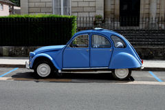 Blue Citroen CV blue parking bay. Royalty Free Stock Image