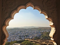 Blue City Jodhpur View, Rajasthan, India. View of the Blue City from the Mehrangarh Fort viewed through a beautiful indian arch Royalty Free Stock Image