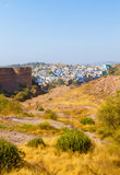 Blue City and Mehrangarh Fort. The Blue City of Jodhpur with the battlements of Mehrangarh Fort Royalty Free Stock Images